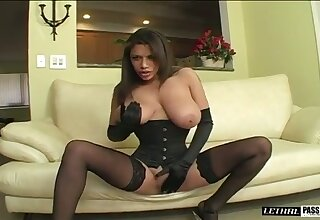 Fantastic big breasted MILF in black stuff thirsts to give a titjob