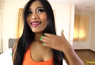 Cute Thai chick with braces has some nice close-fisted pussy and she's not camera shy