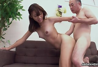 An old man fucks a pretty Japanese babe on the couch and the girl is so pretty