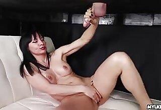 Natasha Ola takes a cumshot on her bare tits
