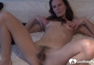 Irresistible chick stops her workout so she tochis finger her hairy pussy on camera.