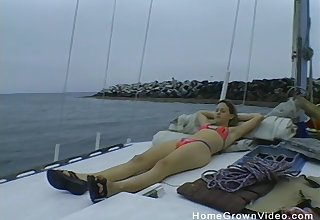 Cute girl gets her cunt filled a friend's hard cock on the ship