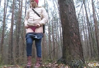 It is unclad outside and this cute vixen has no problem peeing in the woods