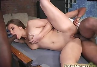 Brunette woman Katie Thomas fucked by two dicks in the first place a conjoin table