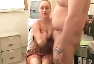 This chubby man lets his naughty girlfriend jack him off unaffected by camera