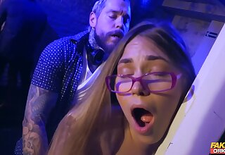 A sexy nerd chick gets fucked against make an issue of wall at a cloudy club